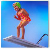 Little Girl Preparing to Dive Off Diving Board